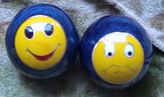 happy ball, and a sad ball set of balls