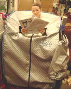 relax far infrared sauna using arm holes & reading